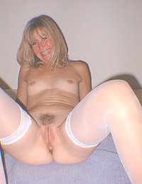 Sunshine isn't shy about putting her lovely body on display, with or without clothes! When this horny milf gets naked, you'll enjoy her firm all naturals and her sleek figure. Spreading her thighs, she happily gives you a long look at her dripping bare twat that is all wet and ready to party.