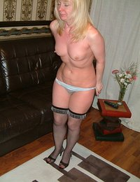 Look at the way stunning Sunshine fills out her dress, complete with thigh high stockings! She may look like she's all business, but this horny blonde is always looking for excuses to peel off her clothes. Watch her get naked and spread her thighs so she can slip her fingers into her tight fuck hole.